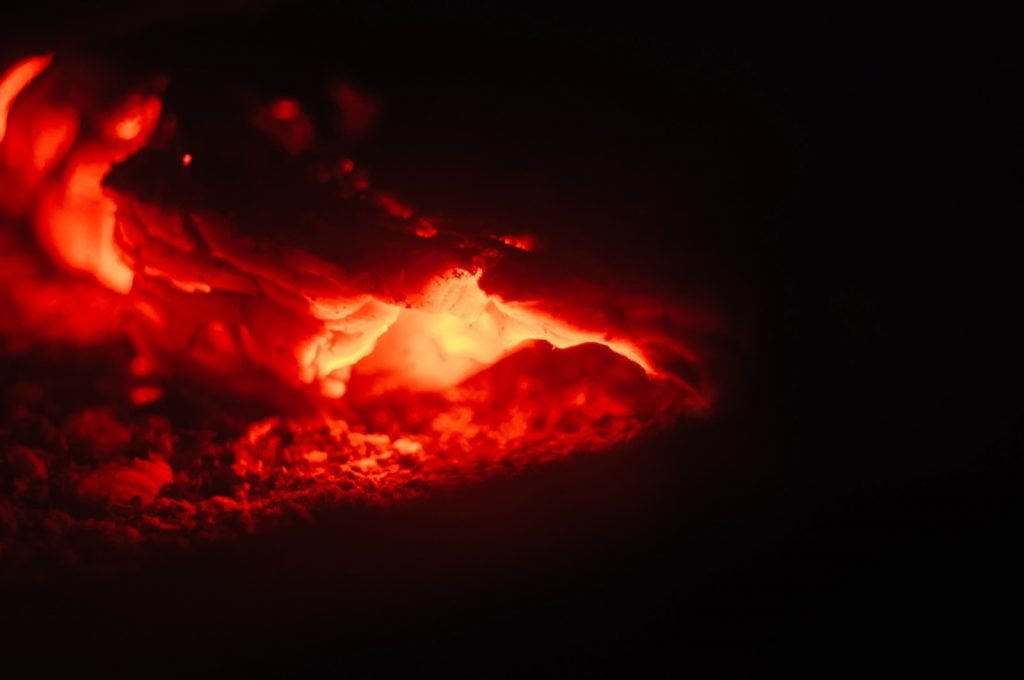 Closeup shot of red fire on a black background