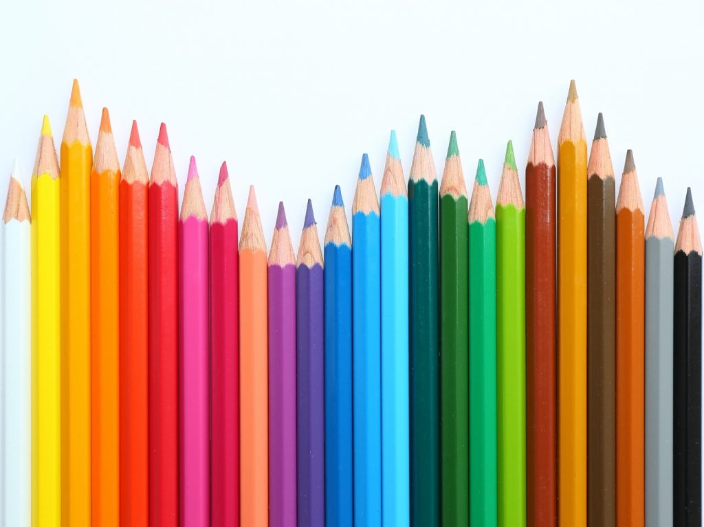 Colored pencils isolated on a bright background