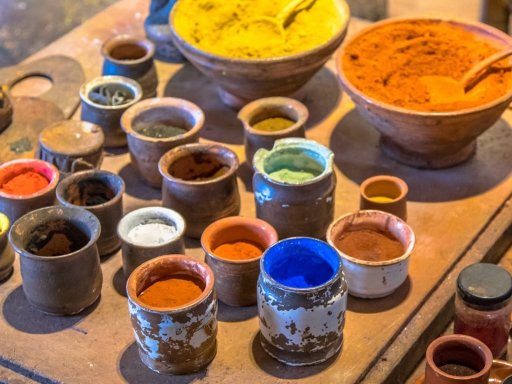 Colored pigment powders in old jars