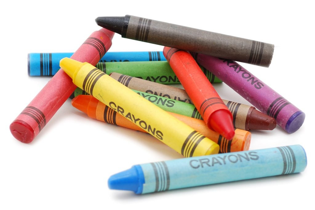 Colorful crayons lying on white background