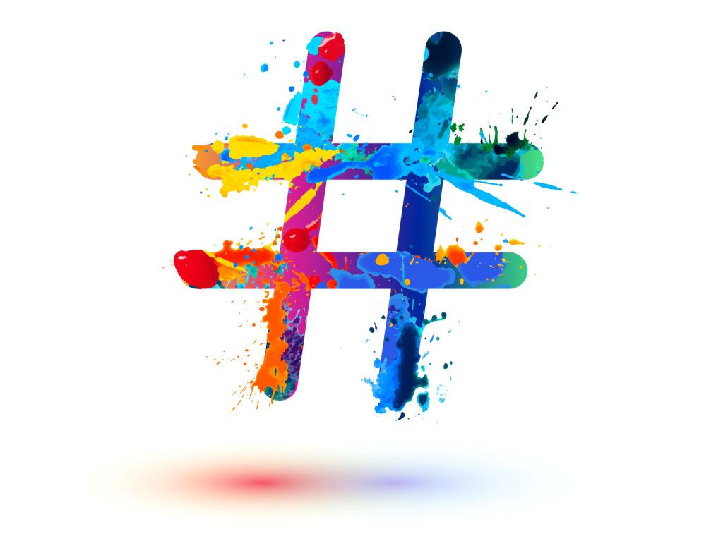 Colorful hashtag sign with splashes of paint