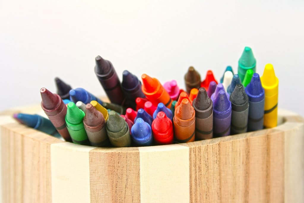 Set of what looks like colored Crayola crayons in wooden holder