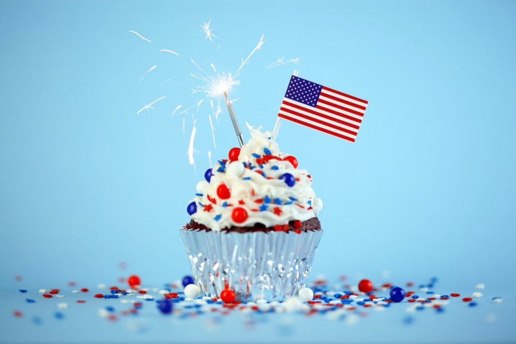 Cupcake with American flag and red, white and blue sprinkles