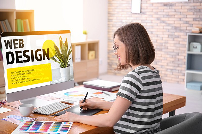 Designer working in office looking at color codes on chart