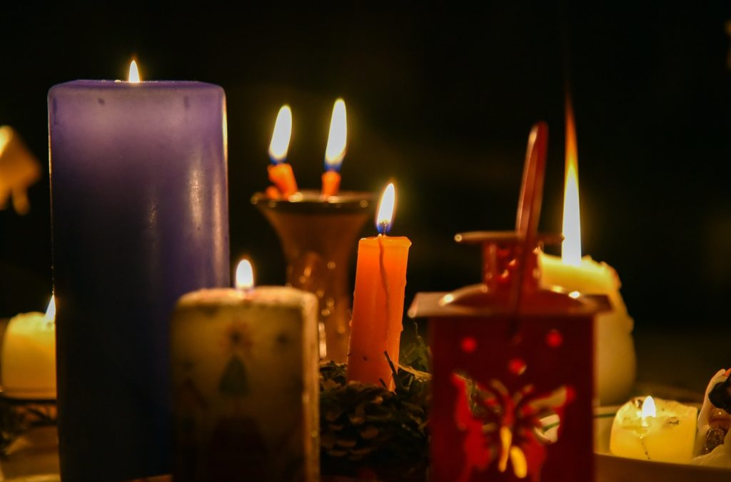 Different candle colors burning in the dark