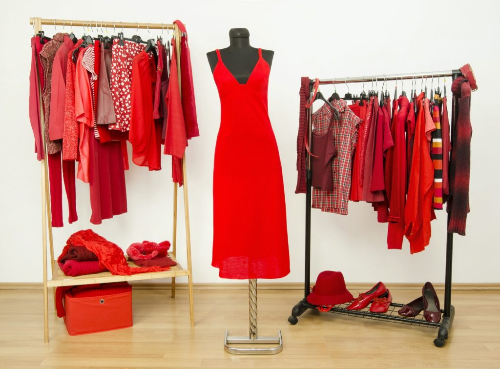 Wardrobe full of all shades of red clothes, shoes and accessories