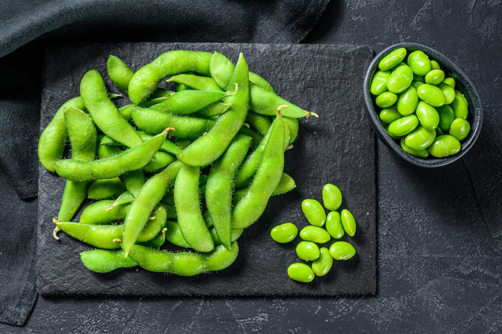 Top view of green edamame soy beans edamame on black background