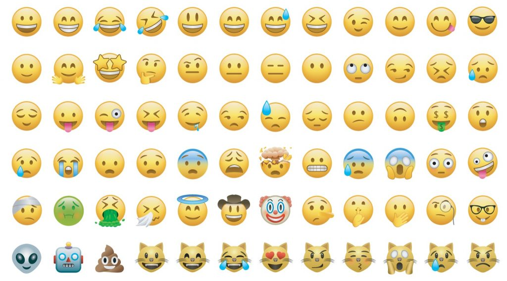 Set of yellow colored smiley faces and emoji icons