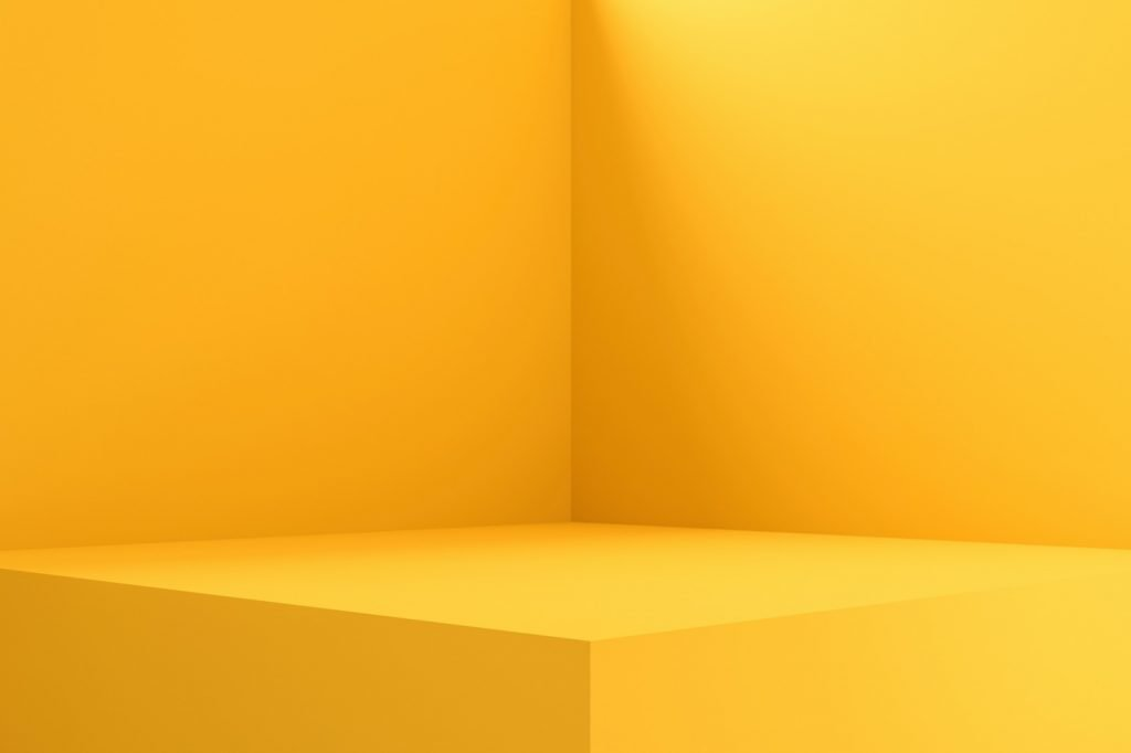 Empty yellow pedestal display for product photography