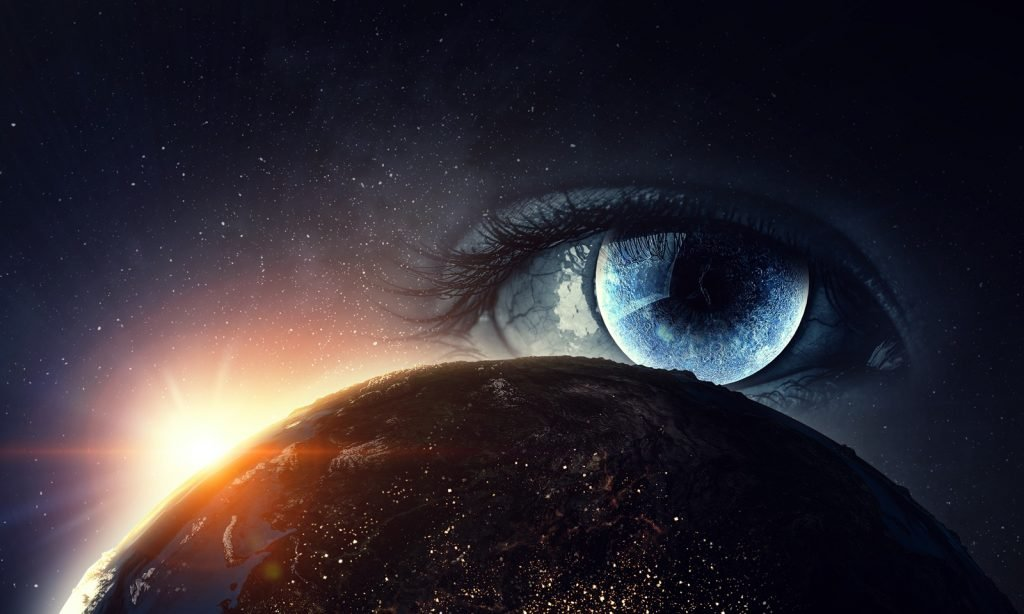 Eye seeing the world in color with the sun rising in the background