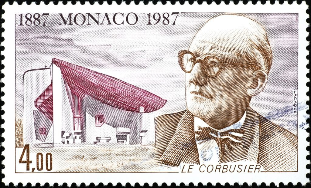 Famous architect Le Corbusier with his iconic white building on a stamp from Monaco