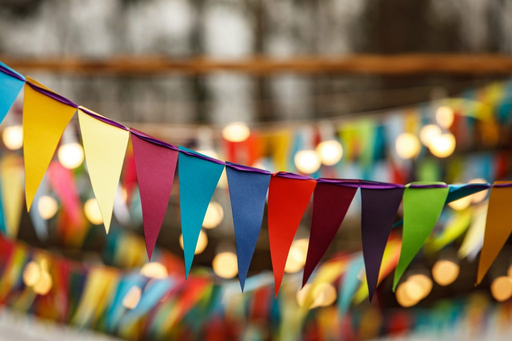 Many flags in symbolic colors at holiday festival