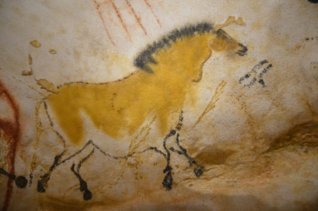 French Lascaux cave painting of horse colored with yellow ochre