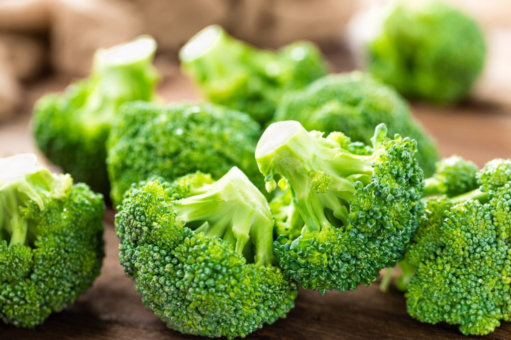 Fresh green broccoli on wooden background