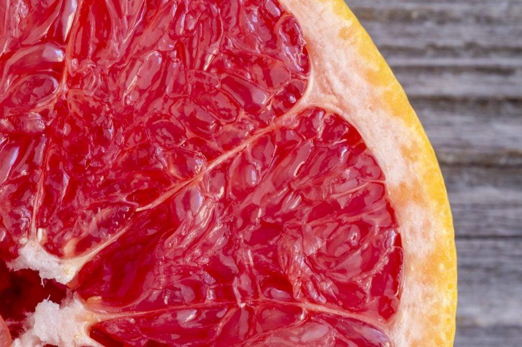 Fresh cut organic ruby red grapefruit