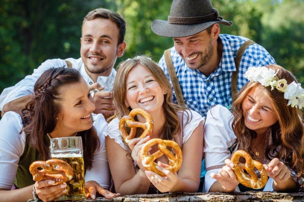 Happy friends from Bavaria celebrating Oktoberfest