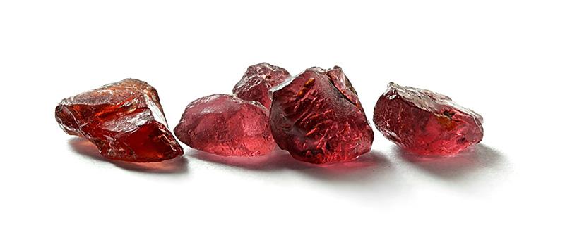 Garnet gems isolated on white background