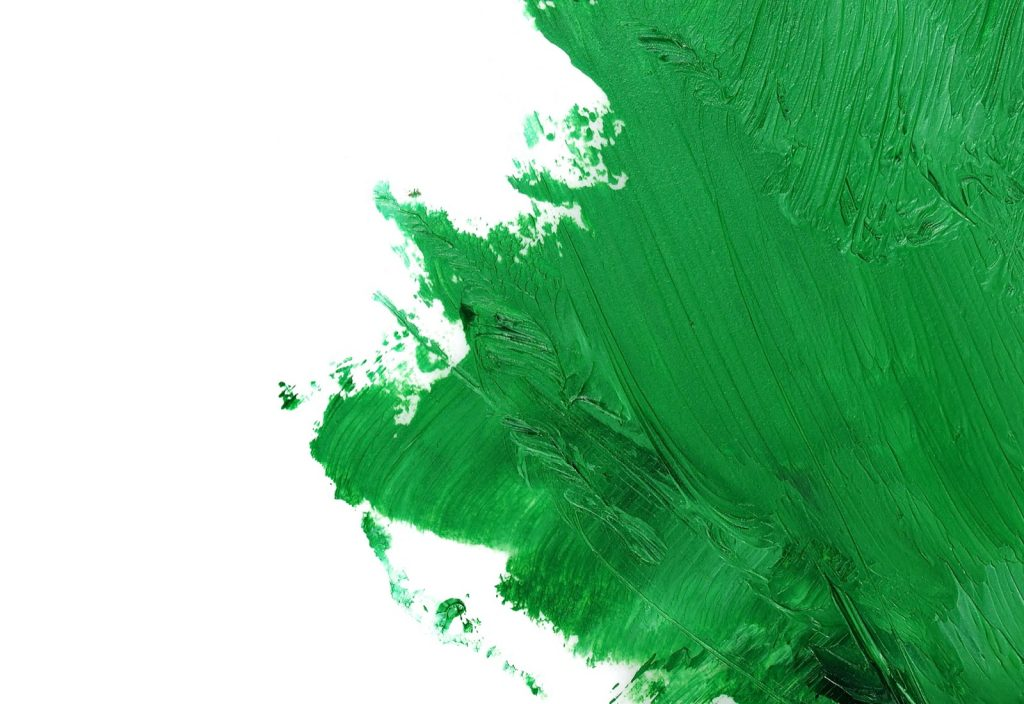 Green colored oil paint brush strokes isolated on white background