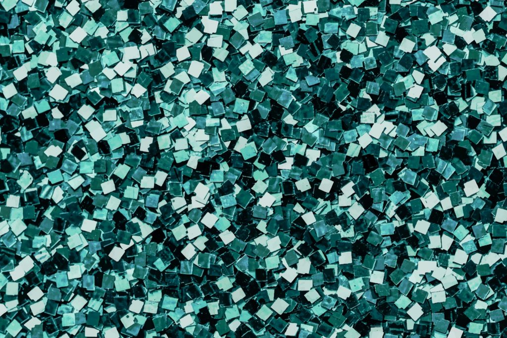Shiny green sequins textured background