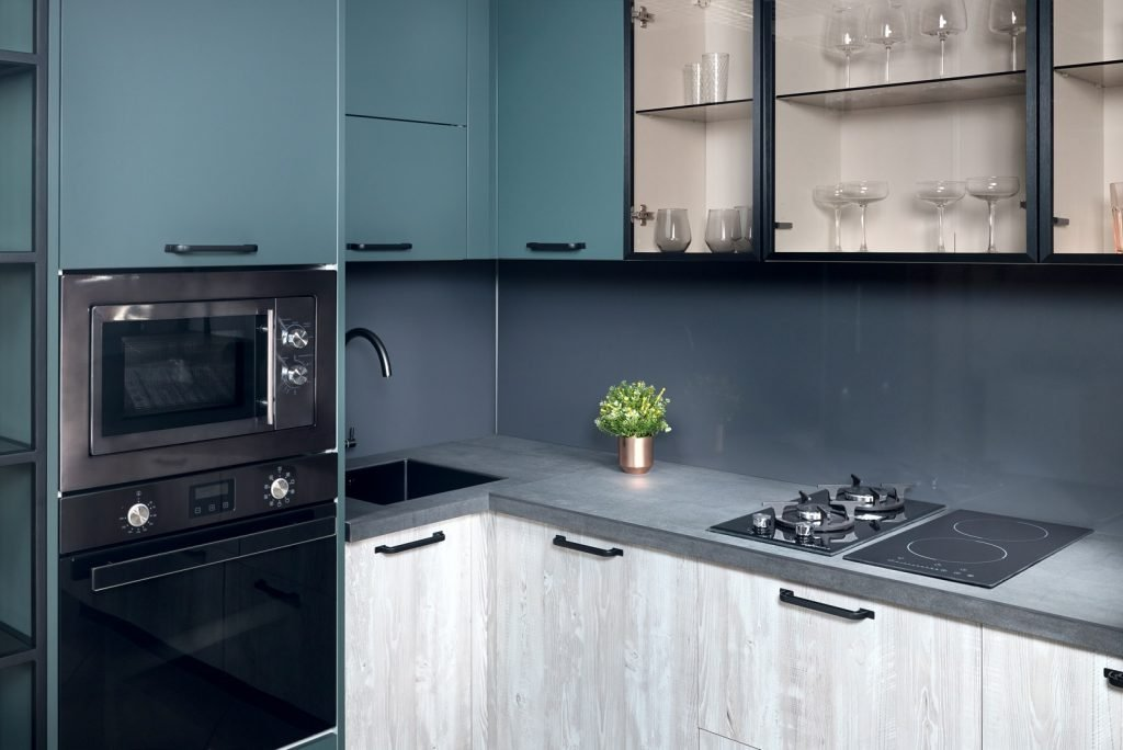 Green and gray kitchen with tuscan stainless steel oven