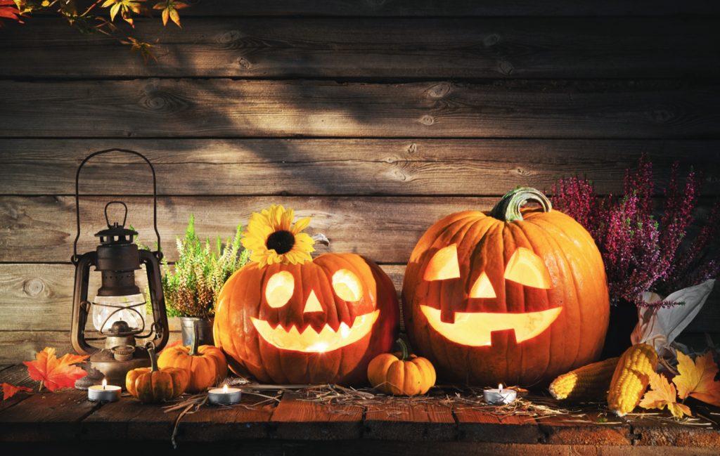 Halloween pumpkin heads jack-o-lantern on a wooden background