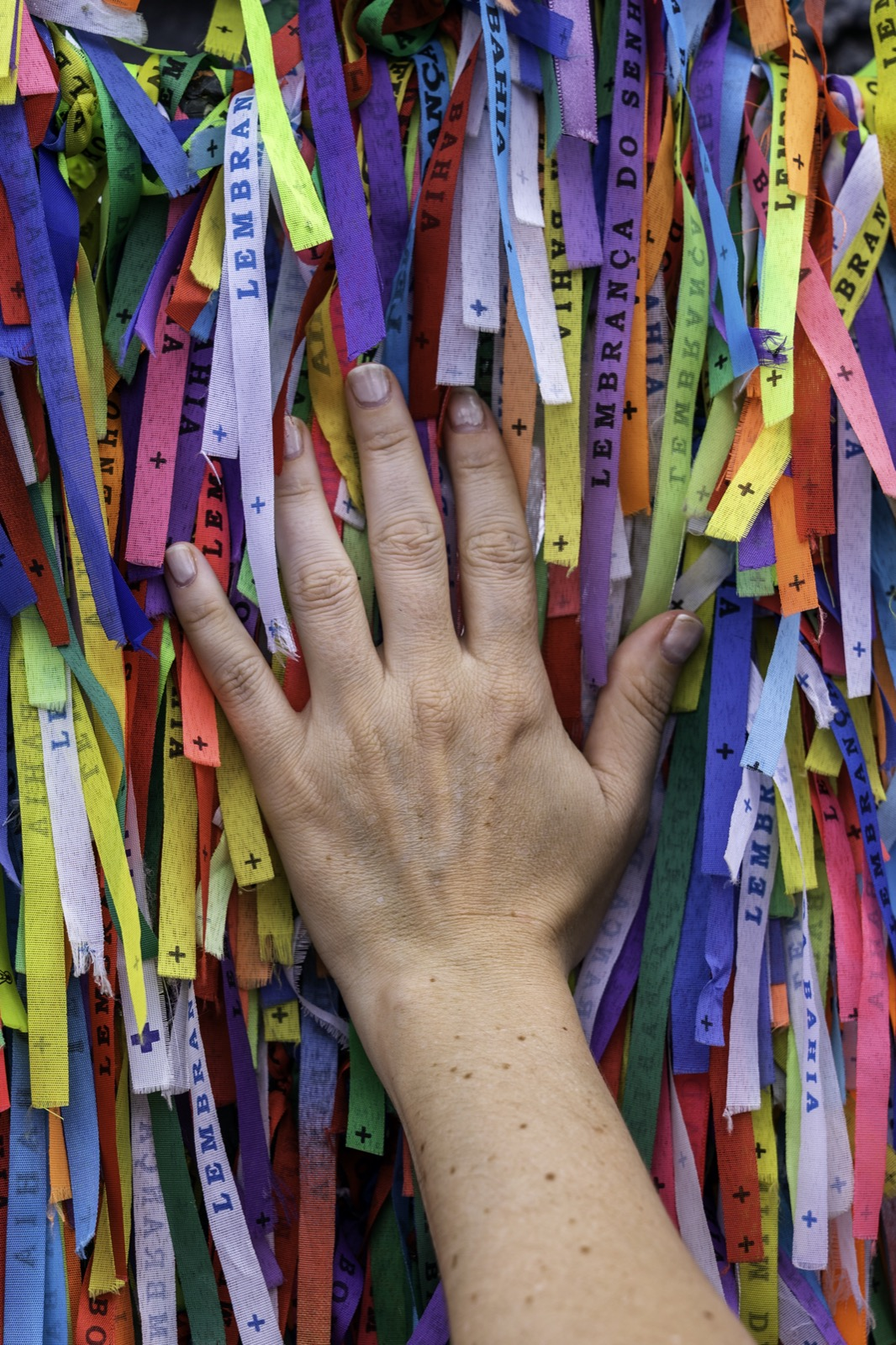 Hand placed on Brazilian wish bracelets in Salvador Brazil