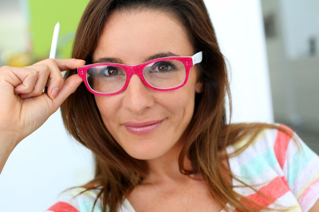 Happy woman with pink eyeglasses