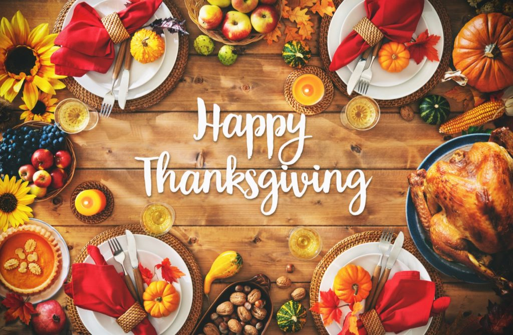 Happy Thanksgiving celebration with colorful dinner setting