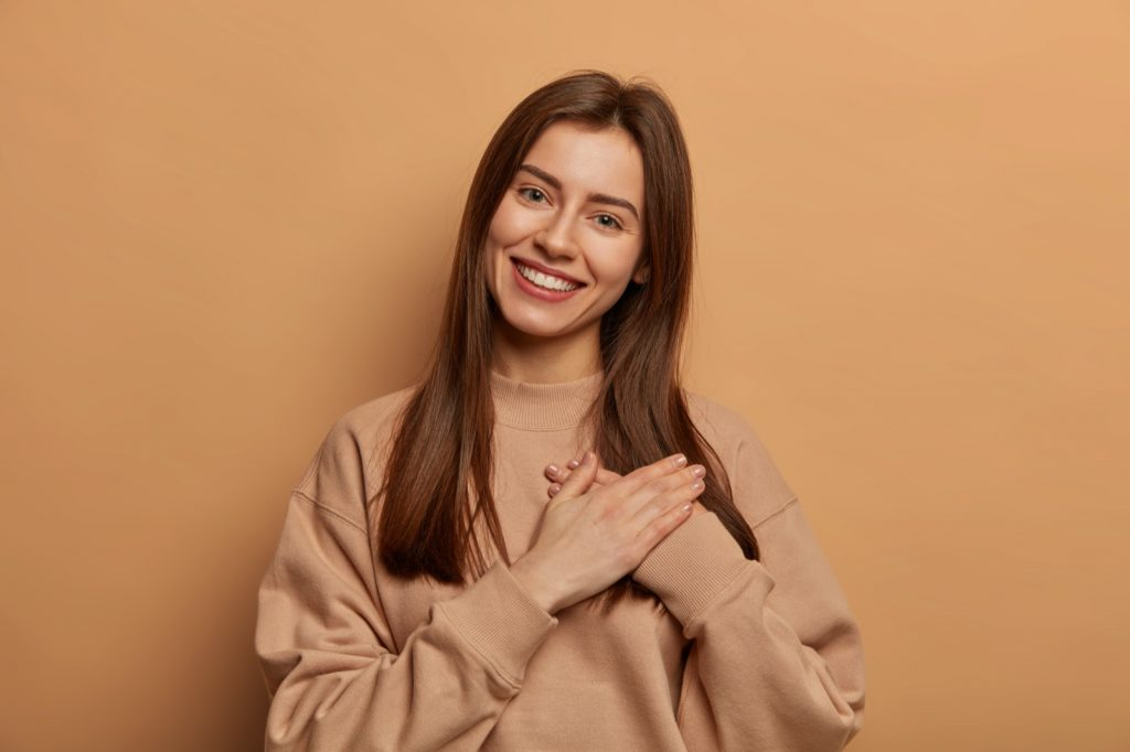 Happy woman wearing brown clothes