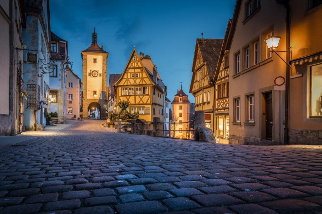 Classic view of the medieval German town Rothenburg ob der Tauber illuminated in evening twilight