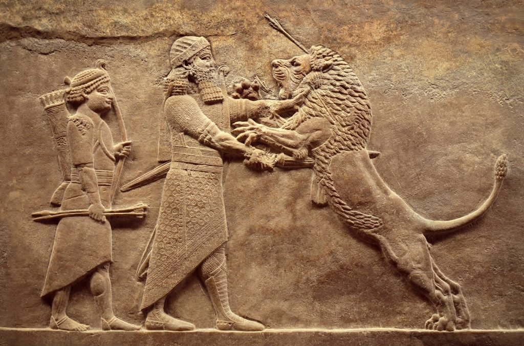 Remains of ancient civilization of Mesopotamia with old carving from the Middle East history that depicts a royal lion hunt