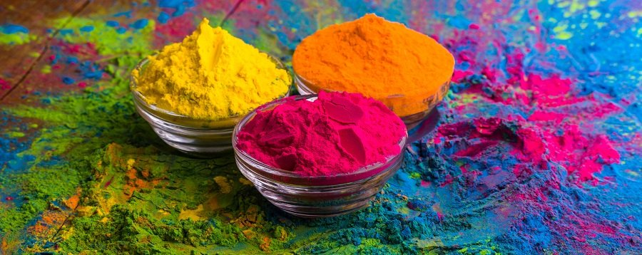 Organic Gulal color powder in bowl for Holi festival, Hindu tradition in Indian culture