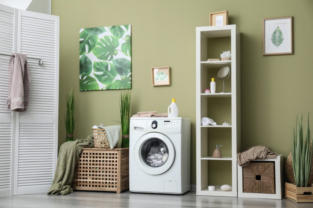 Home laundry room in green colors