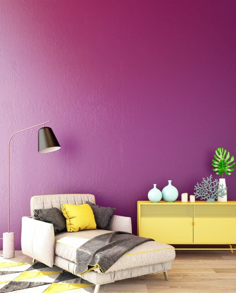 Interior design in modern style using complementary colors with yellow dresser and purple wall