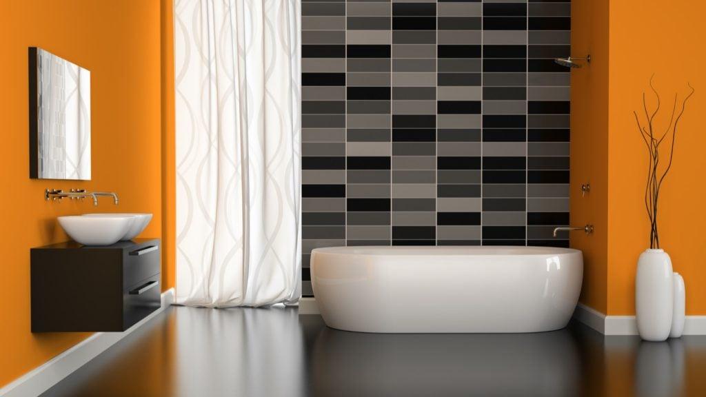 Interior of modern bathroom with orange walls