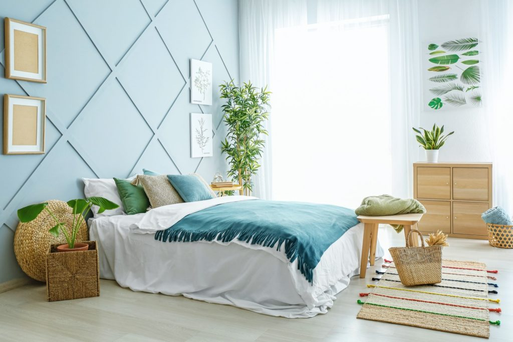 Interior of beautiful modern bedroom with blue and green colors