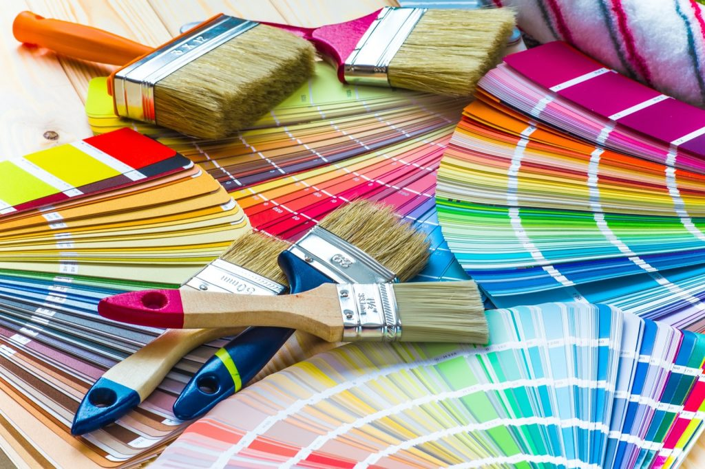 Interior wall painting work table with color swatches and brushes
