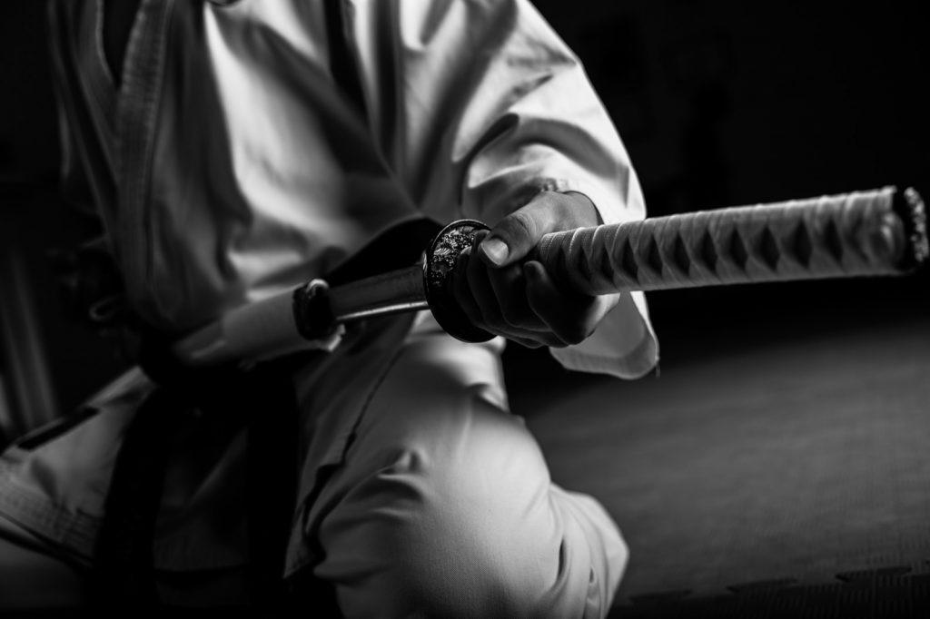 Japanese samurai with katana sword wearing white ritual clothes
