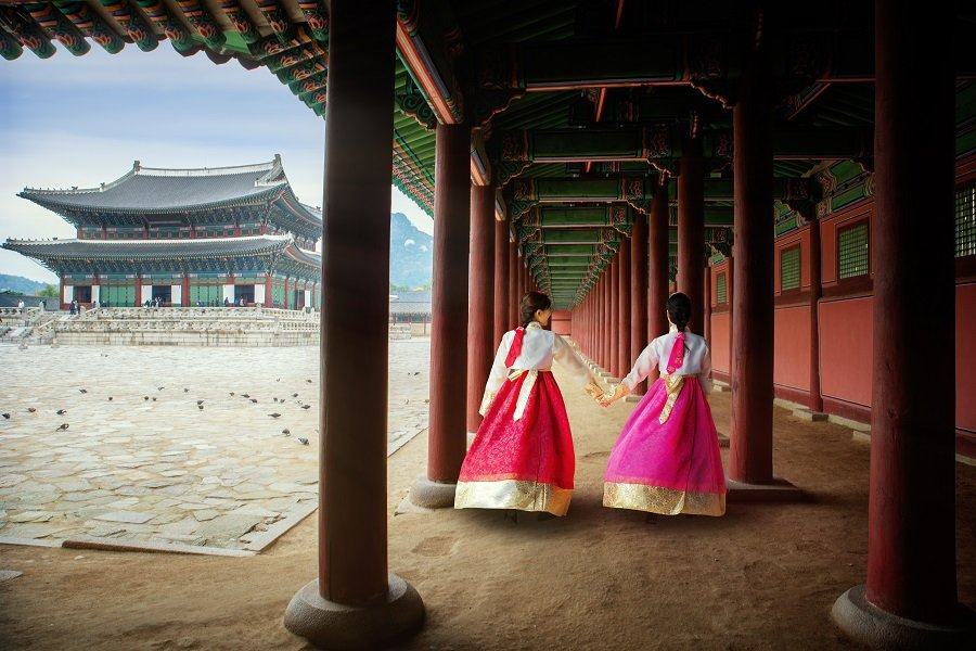 Korean ladies in Hanbok dresses walking in Gyeongbokgung Palace, Seoul