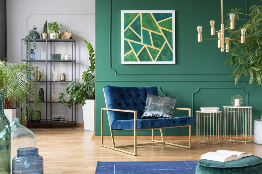 Stylish living room interior design idea with green, blue and gold colors