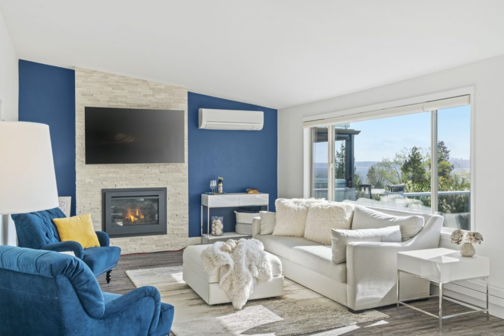 Bright inviting living room painted with blue accent wall
