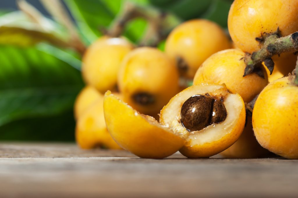 Fresh yellow loquats fruit lying on a table