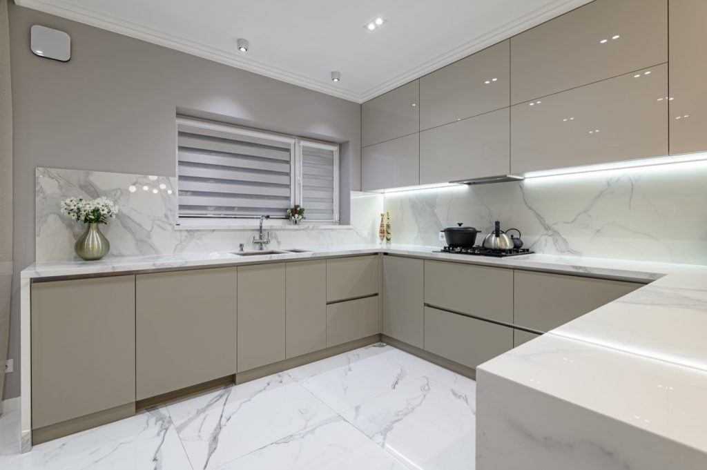 Luxury modern kitchen with hidden appliances and marble floor