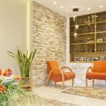 living room with orange sofas and beige walls
