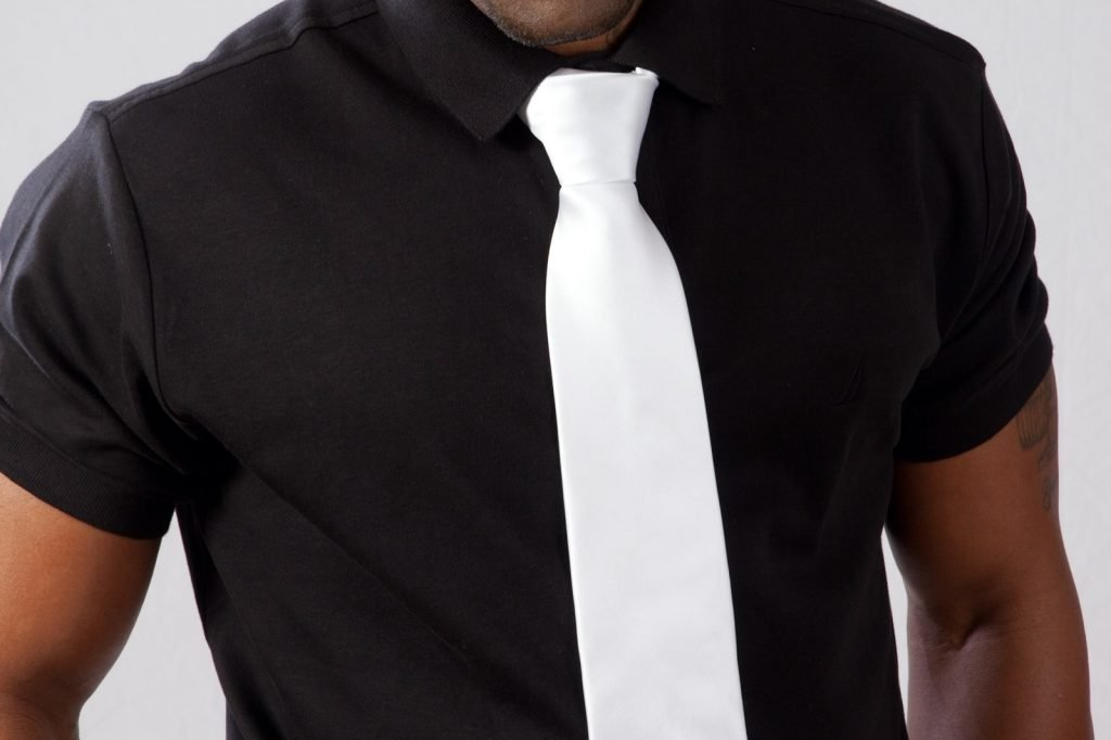 Man in black shirt and white tie