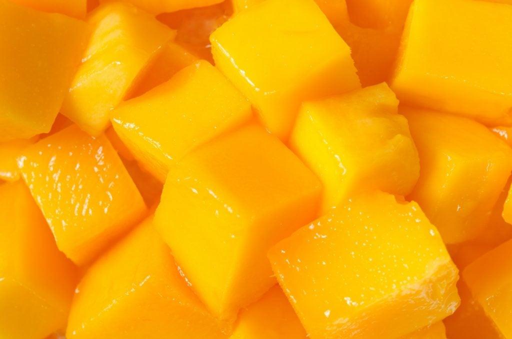 Closeup of bright orange ripe mango cubes