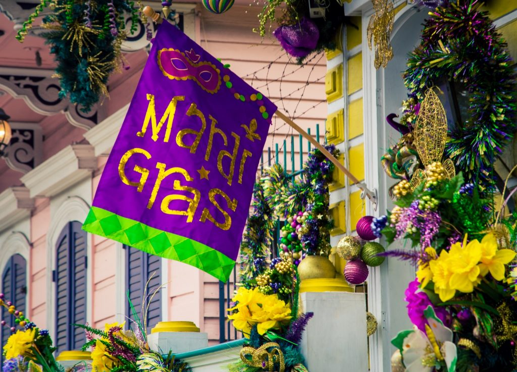Mardi Gras decorations in New Orleans with colorful flag