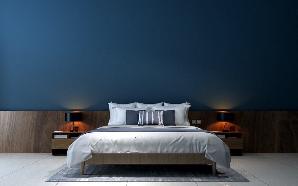 Modern bedroom interior design with blue painted walls and brown wooden bed