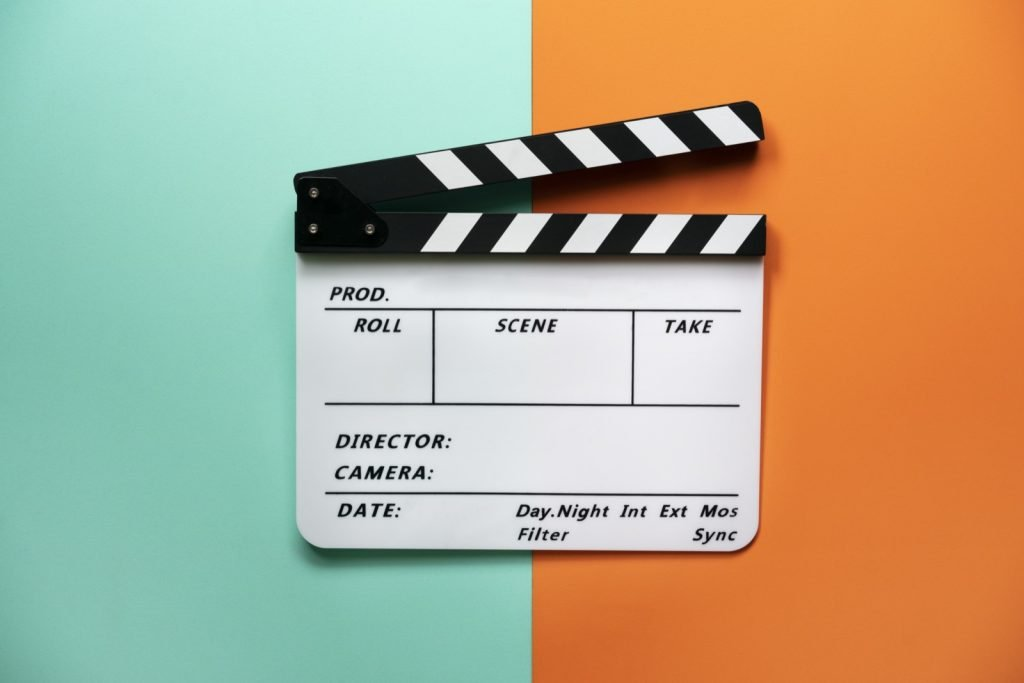Movie clapper board on dual color table background