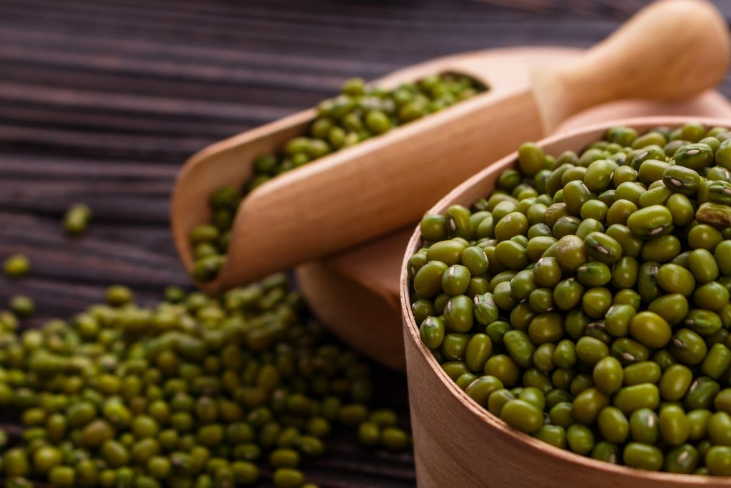 Fresh mung beans on a rustic wooden  table